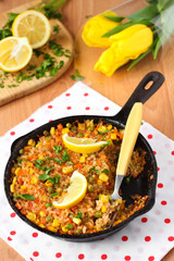 Vegan paella with corn and green peas