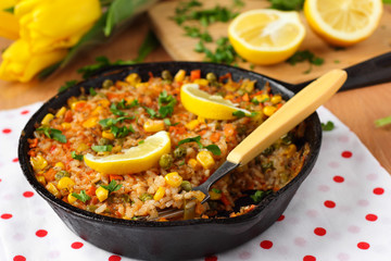 Vegan paella with corn and green peas