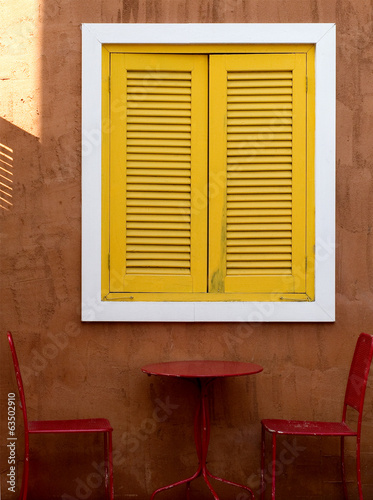 Yellow window and Red Chair in 1960
