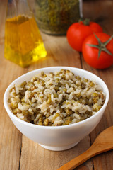 Cooked mung beans with rice on wooden background