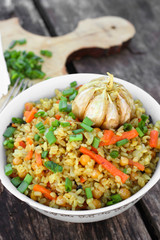 Asian vegetarian bulgur pilaf with chickpeas, carrots and garlic