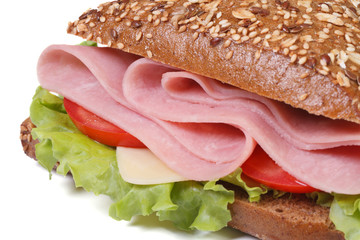 macro sandwich with ham, cheese, tomatoes and lettuce  isolated