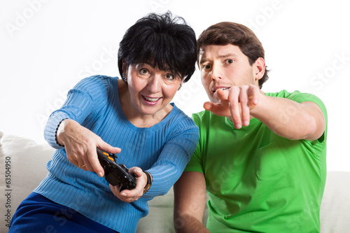 Elderly woman playing on console