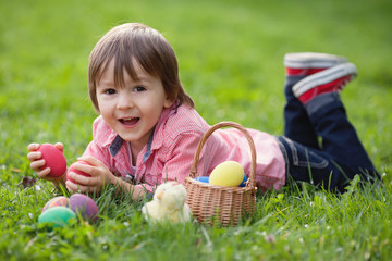 Cute Little Boy Enjoying His Easter Eggs in the Park