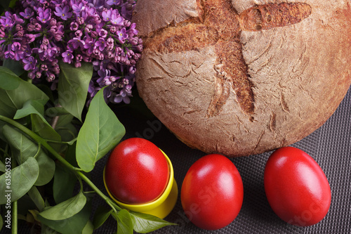 Easter red eggs with bread and lilac