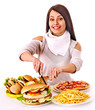 canvas print picture - Woman eating fast food.