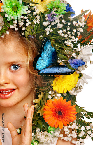 Child with butterfly and flower.