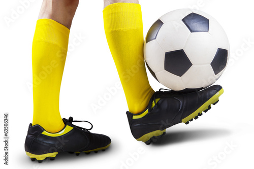 Football player playing a soccer ball