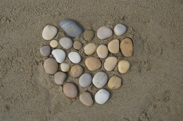 Hearth, pebbles composition on the sand