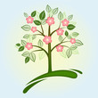 Abstract green spring tree with pink flowers.