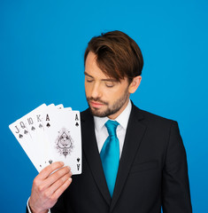 young business man showing playing cards -