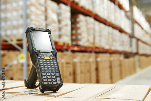 Leinwanddruck Bild barcode scanner at warehouse