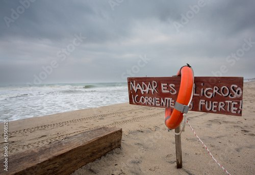 Life buoy and sign dangerous to swim