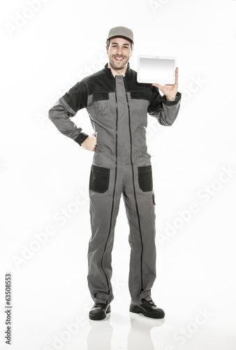 Full length portrait of a technician in a uniform showing a digi