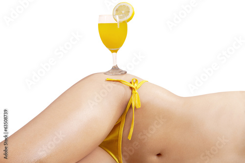 Orange juice on beautiful body