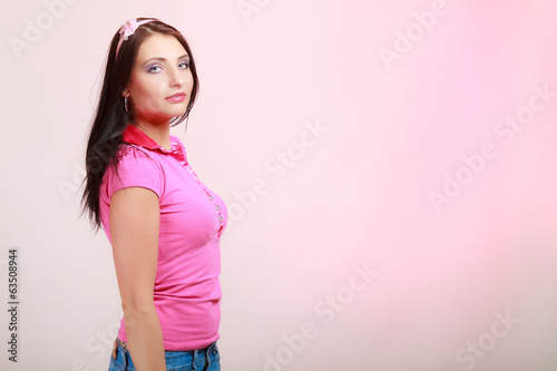 Childish woman infantile girl in pink. Longing for childhood.