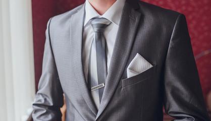 groom getting ready in suit