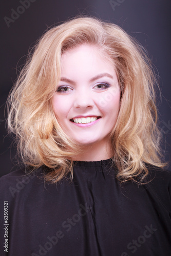 girl with blond wavy hair in hairdressing beauty salon
