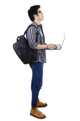 Student with laptop looking copyspace