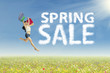 Woman jumping during spring sale