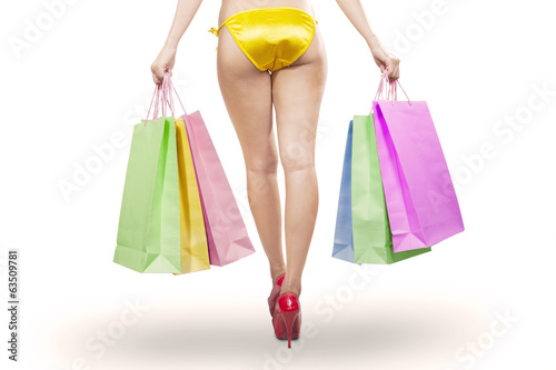 Woman long legs holding shopping bags