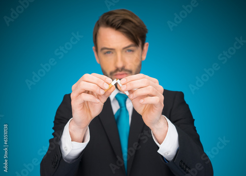 business holding a broken cigarette