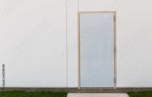 White wall with gray door