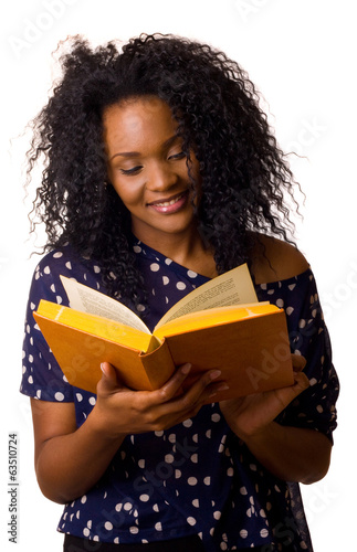 young woman reading a book isolated on a white background.
