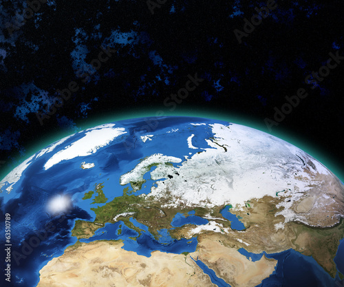 Planet Earth with sun rising over European countries