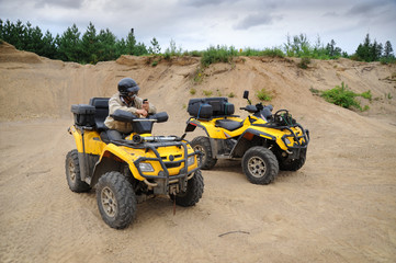 Two yellow ATV