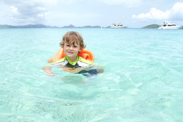 Child Swimming in Tropical Ocean