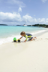 Child having Fun on Tropical Beach near Ocean