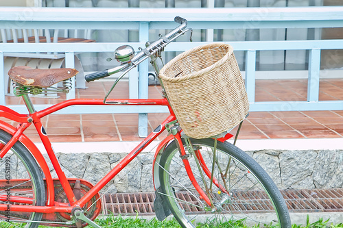 Basket and red bicycle
