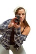 Young woman with brown hair holds camera