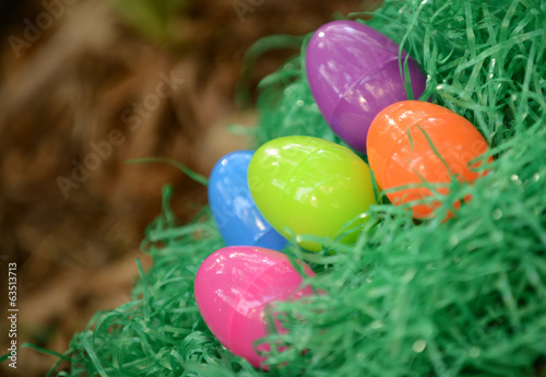plastic easter eggs in fake grass