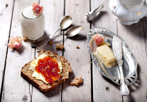 Bread with butter, jam and yogurt