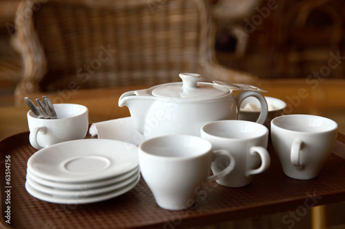 White tea set on table