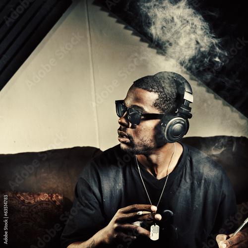 Leinwanddruck Bild man in music studio smoking weed