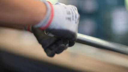 hands holding close and isolate a bolt on a pipe