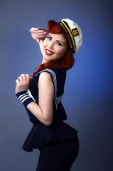 Sailor pin up girl saluting