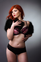 Confident curvy woman posing in lingerie