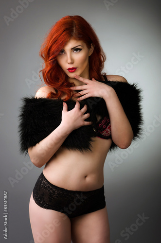 redhead woman posing in sexy lingerie
