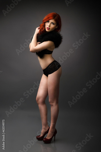 Studio portrait of a confident curvy woman posing in lingerie
