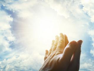 Praying hands in sky