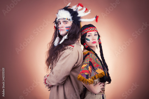 Native american couple vintage image on brown