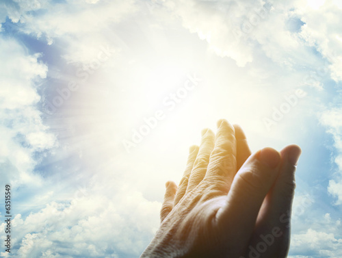 Praying hands in sky