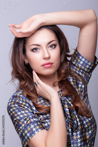 Fashion woman professional make up posing in studio