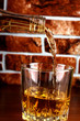 Whiskey glass on brick