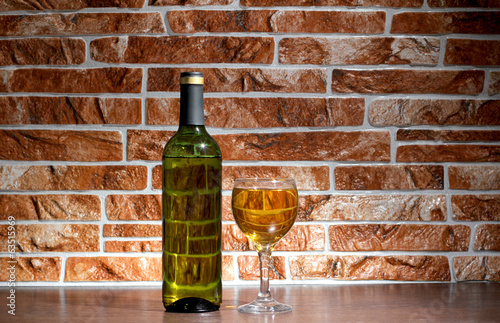 Wine of bottle on brick