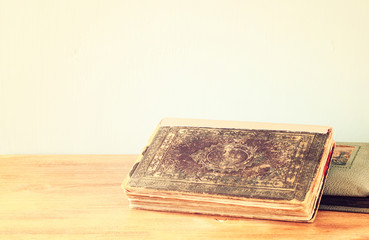 old book on wooden shelf. retro filter.